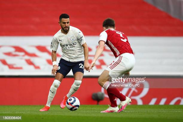 Riyad Mahrez of Manchester City controls the ball whilst under pressure from Kieran Tierney of Arsenal during the Premier League match between...