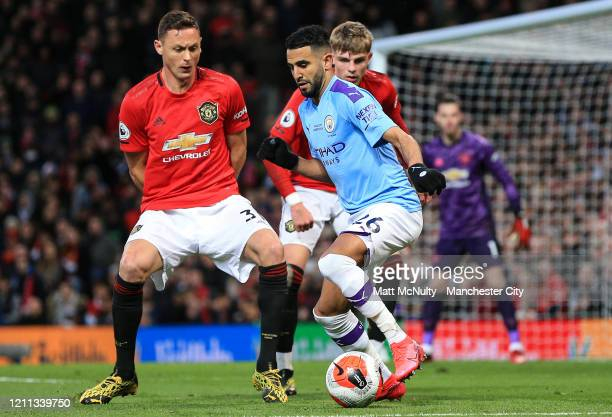 Riyad Mahrez of Manchester City in action during the Premier League match between Manchester United and Manchester City at Old Trafford on March 08...
