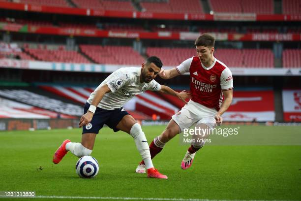Riyad Mahrez of Manchester City in action with Kieran Tierney of Arsenal during the Premier League match between Arsenal and Manchester City at...