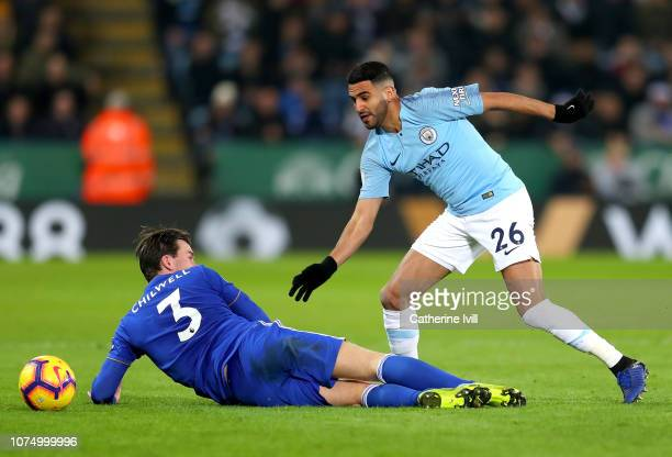Riyad Mahrez of Manchester City is challenged by Ben Chilwell of Leicester City during the Premier League match between Leicester City and Manchester...