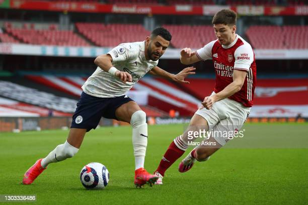 Riyad Mahrez of Manchester City is challenged by Kieran Tierney of Arsenal during the Premier League match between Arsenal and Manchester City at...