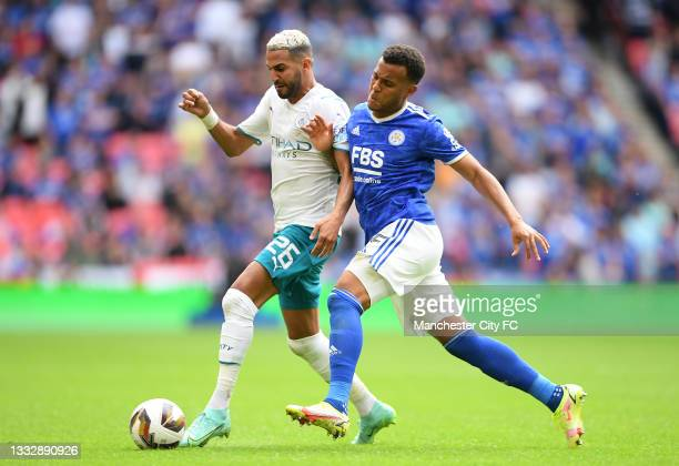 Riyad Mahrez of Manchester City is challenged by Ryan Bertrand of Leicester City during The FA Community Shield Final between Manchester City and...