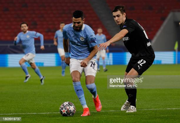 Riyad Mahrez of Manchester City is closed down by Daniel Grimshaw of Manchester City during the UEFA Champions League Round of 16 match between...
