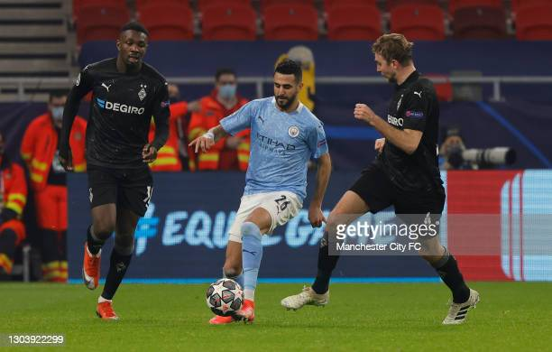 Riyad Mahrez of Manchester City is closed down by Marcus Thuram and Christoph Kramer of Borussia Monchengladbach during the UEFA Champions League...