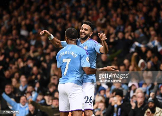 Riyad Mahrez of Manchester City is congratulated by Raheem Sterling after scoring the second goal during the Premier League match between Manchester...