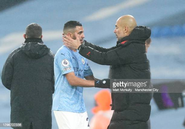 Riyad Mahrez of Manchester City is embraced by Manager of Manchester City, Pep Guardiola after being substituted during the Premier League match...