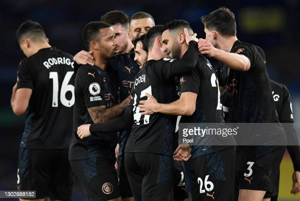 Riyad Mahrez of Manchester City is is congratulated by Phil Foden and team mates after scoring their side's second goal during the Premier League...