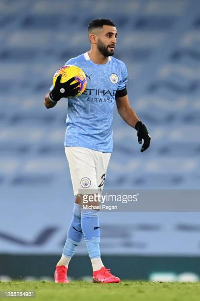 Riyad Mahrez of Manchester City is seen with the match ball after scoring a hattrick following the Premier League match between Manchester City and...