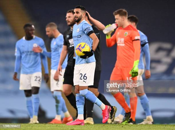 Riyad Mahrez of Manchester City is seen with the match ball after scoring a hattrick during the Premier League match between Manchester City and...