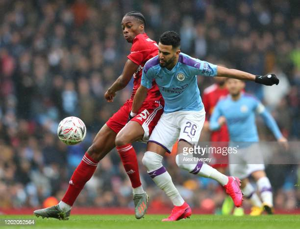 Riyad Mahrez of Manchester City is tackled by Terence Kongolo of Fulham during the FA Cup Fourth Round match between Manchester City and Fulham at...