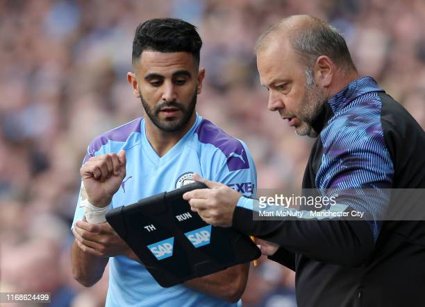 Riyad Mahrez of Manchester City looks at an iPad on the bench during the Premier League match between Manchester City and Tottenham Hotspur at Etihad...
