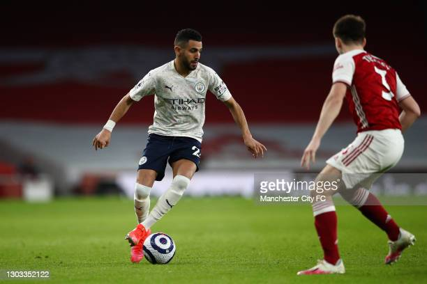 Riyad Mahrez of Manchester City on the ball during the Premier League match between Arsenal and Manchester City at Emirates Stadium on February 21,...