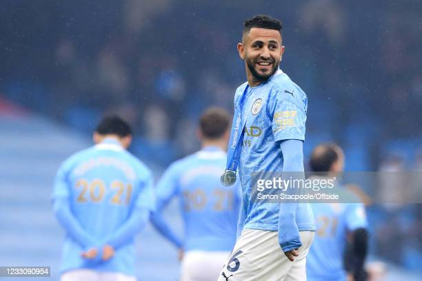 Riyad Mahrez of Manchester City parades his winners' medal after the Premier League match between Manchester City and Everton at Etihad Stadium on...