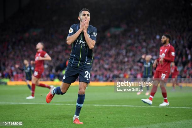 Riyad Mahrez of Manchester City reacts after a missed chance during the Premier League match between Liverpool FC and Manchester City at Anfield on...