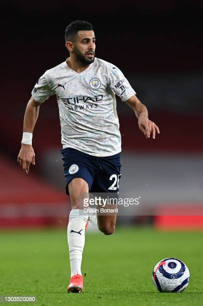 Riyad Mahrez of Manchester City runs with the ball during the Premier League match between Arsenal and Manchester City at Emirates Stadium on...
