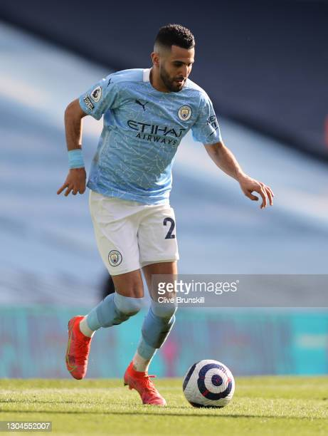 Riyad Mahrez of Manchester City runs with the ball during the Premier League match between Manchester City and West Ham United at Etihad Stadium on...