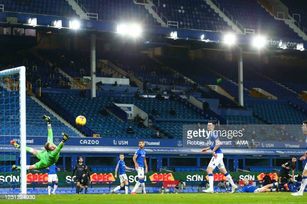 Riyad Mahrez of Manchester City scores a goal to make it 1-2 during the Premier League match between Everton and Manchester City at Goodison Park on...