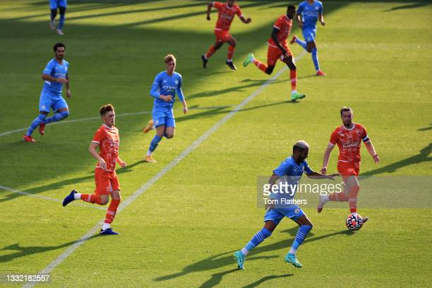 Riyad Mahrez of Manchester City scores his sides second goal during the pre-season friendly match between Manchester City and Blackpool at Manchester...