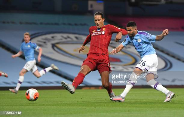 Riyad Mahrez of Manchester City scores his team's fifth goal as he is is challenged by Virgil van Dijk of Liverpool but it is disallowed by VAR...