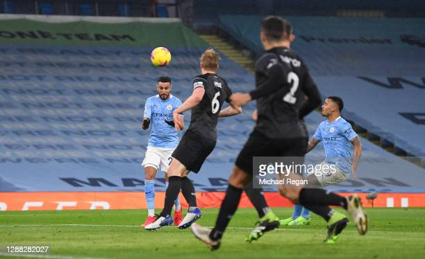 Riyad Mahrez of Manchester City scores his team's fifth goal during the Premier League match between Manchester City and Burnley at Etihad Stadium on...