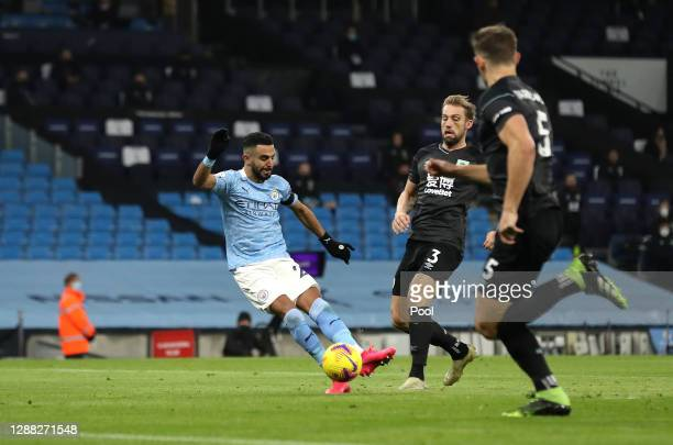 Riyad Mahrez of Manchester City scores his team's first goal during the Premier League match between Manchester City and Burnley at Etihad Stadium on...