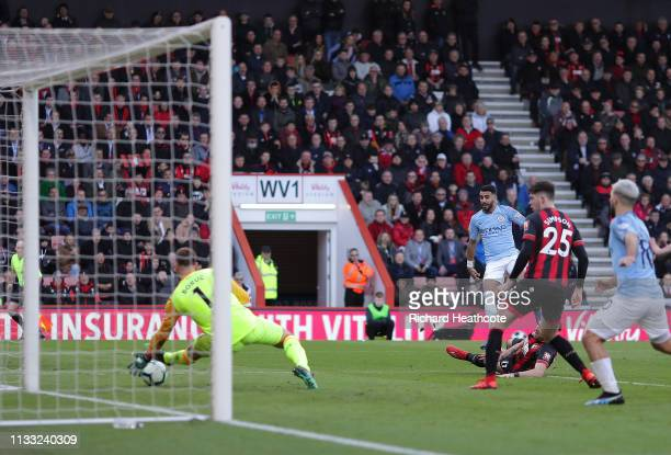 Riyad Mahrez of Manchester City scores his team's first goal past Artur Boruc of AFC Bournemouth during the Premier League match between AFC...