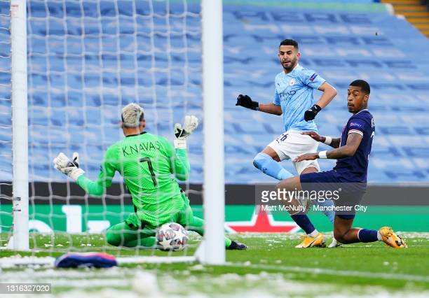 Riyad Mahrez of Manchester City scores his teams first goal with during the UEFA Champions League Semi Final Second Leg match between Manchester City...
