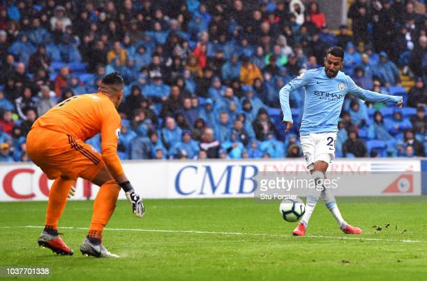 Riyad Mahrez of Manchester City scores his team's fourth goal during the Premier League match between Cardiff City and Manchester City at Cardiff...
