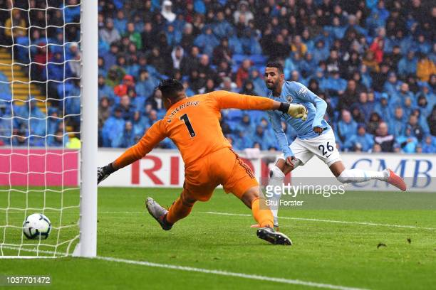 Riyad Mahrez of Manchester City scores his team's fourth goal past Neil Etheridge of Cardiff City during the Premier League match between Cardiff...