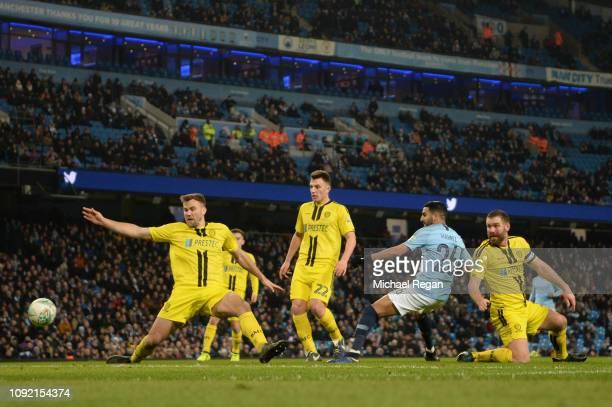 Riyad Mahrez of Manchester City scores his team's ninth goal during the Carabao Cup Semi Final First Leg match between Manchester City and Burton...