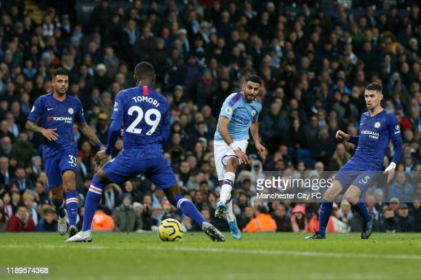 Riyad Mahrez of Manchester City scores his team's second goal during the Premier League match between Manchester City and Chelsea FC at Etihad...
