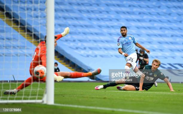Riyad Mahrez of Manchester City scores his team's second goal during the Premier League match between Manchester City and Burnley FC at Etihad...