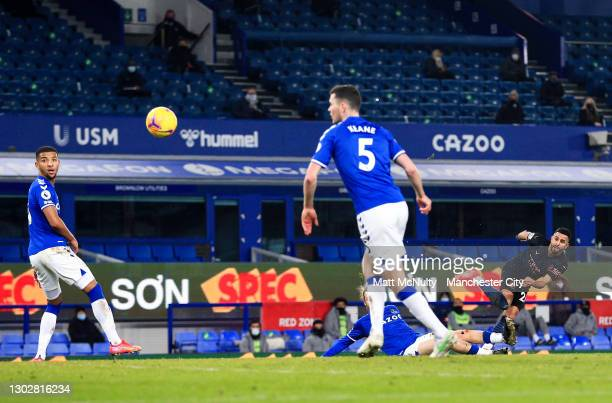 Riyad Mahrez of Manchester City scores his teams second goal during the Premier League match between Everton and Manchester City at Goodison Park on...