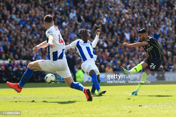 Riyad Mahrez of Manchester City scores his team's third goal during the Premier League match between Brighton Hove Albion and Manchester City at...