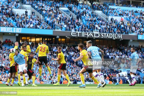 Riyad Mahrez of Manchester City scores his teams third goal during the Premier League match between Manchester City and Watford FC at Etihad Stadium...