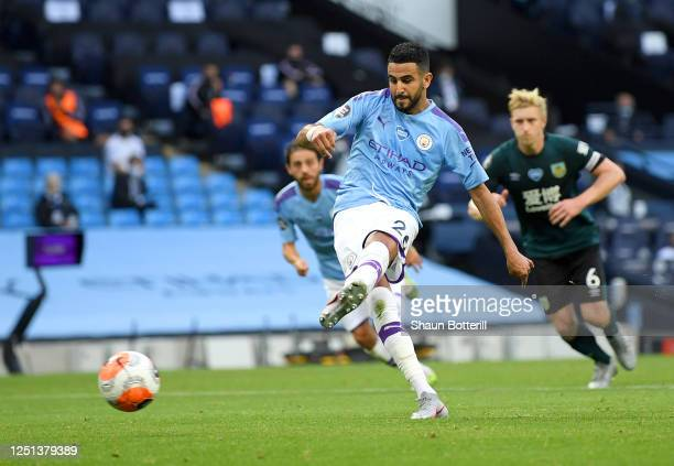 Riyad Mahrez of Manchester City scores his teams third goal from the penalty spot during the Premier League match between Manchester City and Burnley...