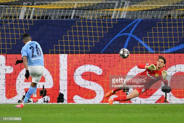 Riyad Mahrez of Manchester City scores their side's first goal past Marwin Hitz of Borussia Dortmund from the penalty spot during the UEFA Champions...
