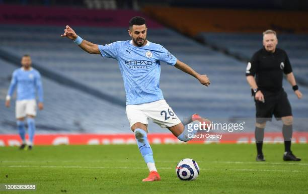 Riyad Mahrez of Manchester City scores their side's fourth goal during the Premier League match between Manchester City and Southampton at Etihad...