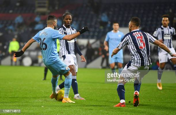 Riyad Mahrez of Manchester City scores their team's fourth goal during the Premier League match between West Bromwich Albion and Manchester City at...