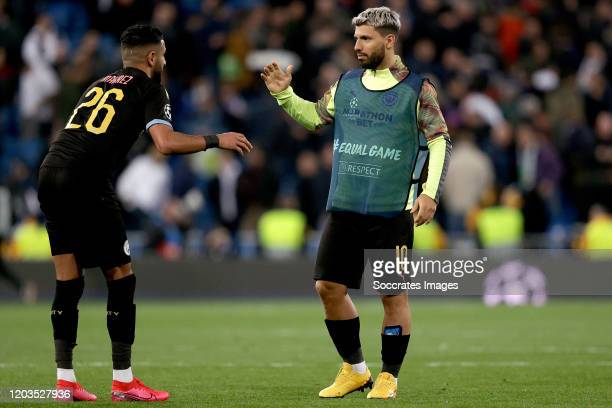 Riyad Mahrez of Manchester City Sergio Aguero of Manchester City celebrates the victory during the UEFA Champions League match between Real Madrid v...