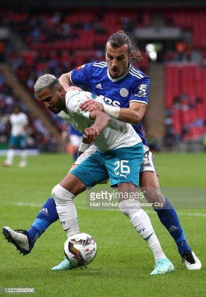Riyad Mahrez of Manchester City shields the ball from Caglar Soeyuencue of Leicester City during The FA Community Shield Final between Manchester...