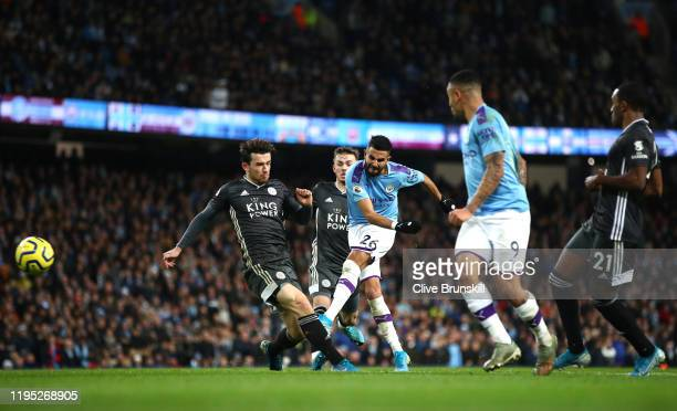 Riyad Mahrez of Manchester City shoots during the Premier League match between Manchester City and Leicester City at Etihad Stadium on December 21...