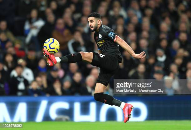 Riyad Mahrez of Manchester City stretches to control the ball during the Premier League match between Tottenham Hotspur and Manchester City at...