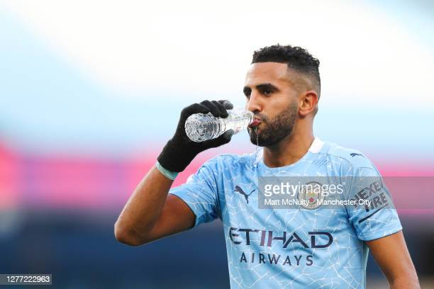 Riyad Mahrez of Manchester City takes a drink of water during the Premier League match between Manchester City and Leicester City at Etihad Stadium...