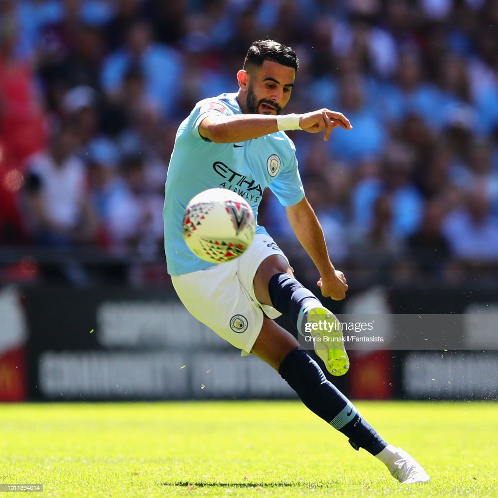 https://media.gettyimages.com/photos/riyad-mahrez-of-manchester-city-takes-a-shot-during-the-fa-community-picture-id1011394014