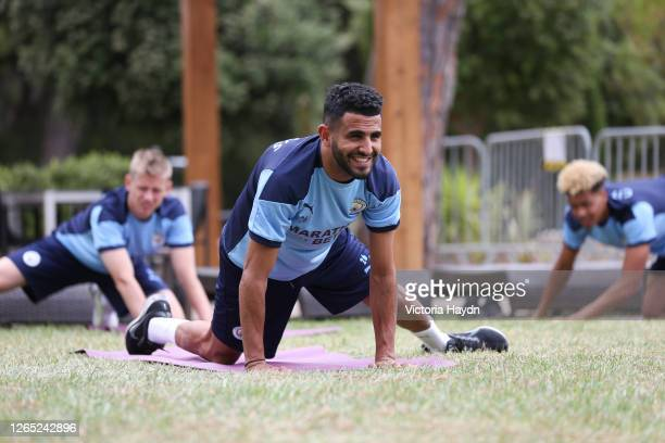 Riyad Mahrez of Manchester City takes part in a stretching session in the build up to the UEFA Champions League Quarter Final match at the team hotel...