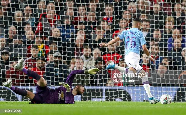 Riyad Mahrez of Manchester City takes the ball around David De Gea of Manchester United and scores his sides second goal during the Carabao Cup Semi...