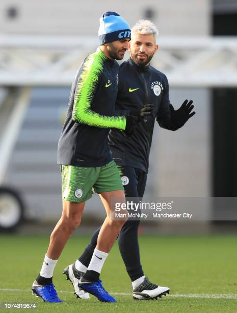 Riyad Mahrez of Manchester City talks with Sergio Aguero during the training session at Manchester City Football Academy on December 17 2018 in...
