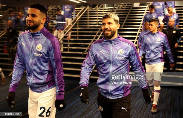 Riyad Mahrez of Manchester City walks with Sergio Aguero of Manchester City through the tunnel during the Premier League match between Manchester...