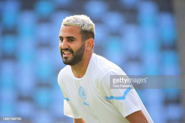 Riyad Mahrez of Manchester City warms up ahead of the pre-season friendly match between Manchester City and Blackpool at Manchester City Football...